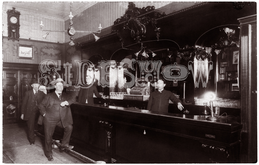 large man at bar saloon vintage photo