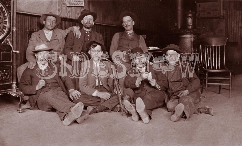 tired men saloon vintage photo