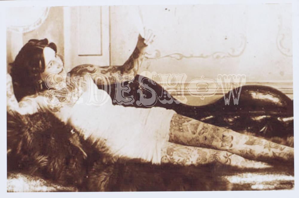 tattoo reclining fur woman