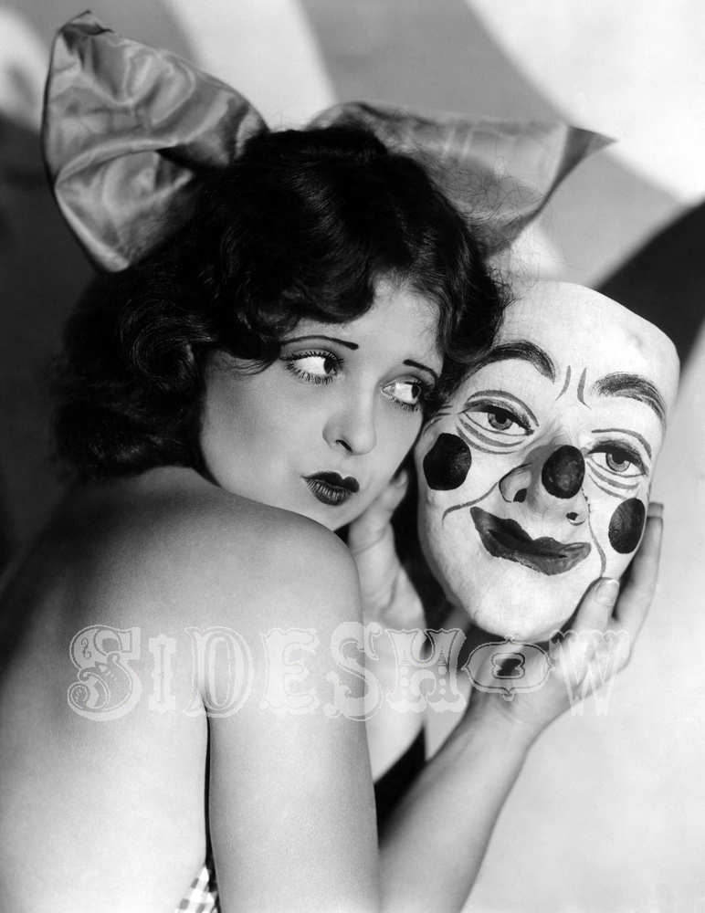 floppy eared woman holding a clown mask